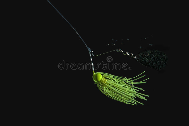 Esca di pesca verde del filatore immagini stock libere da diritti