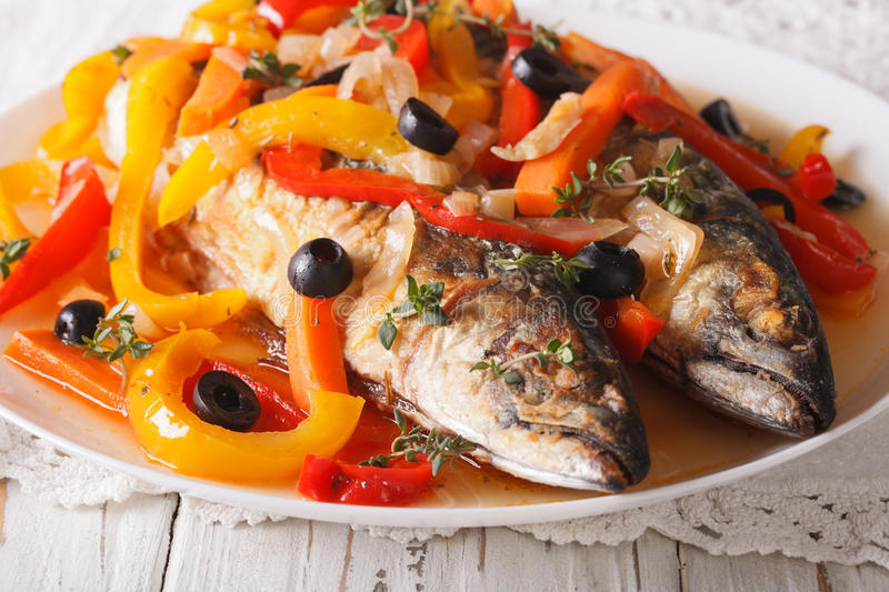 Escabeche fish: mackerel in vegetable marinade close-up. horizon. Escabeche fish: mackerel in vegetable marinade close-up on a plate on the table. horizontal royalty free stock images