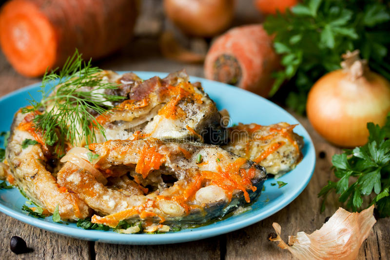 Escabeche of fish with vegetables, marinated fish with onion and royalty free stock photo