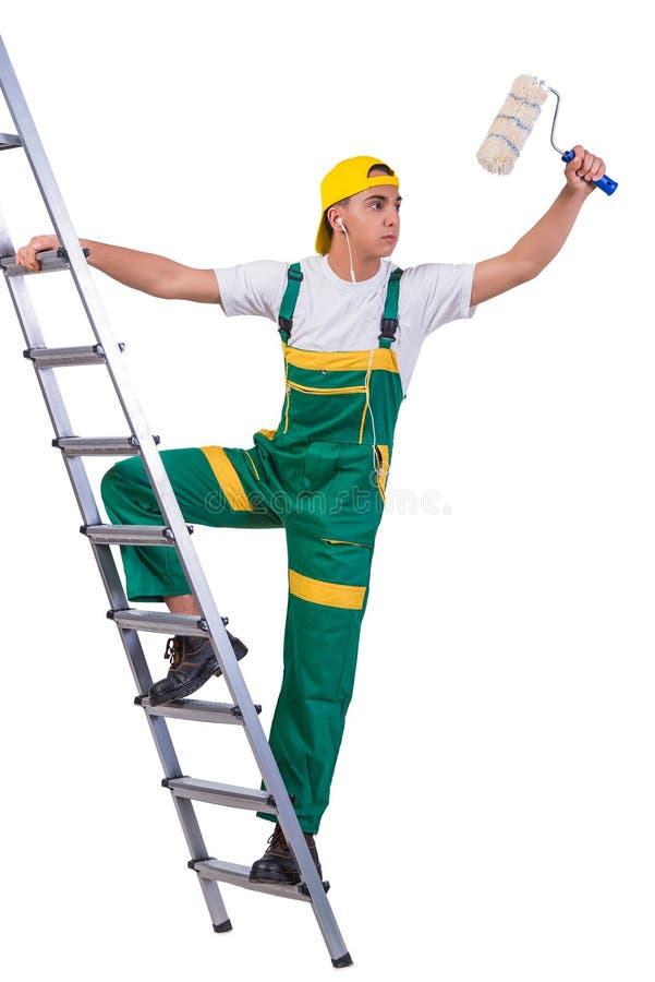 A escada de escalada do pintor novo do reparador isolada no branco imagem de stock
