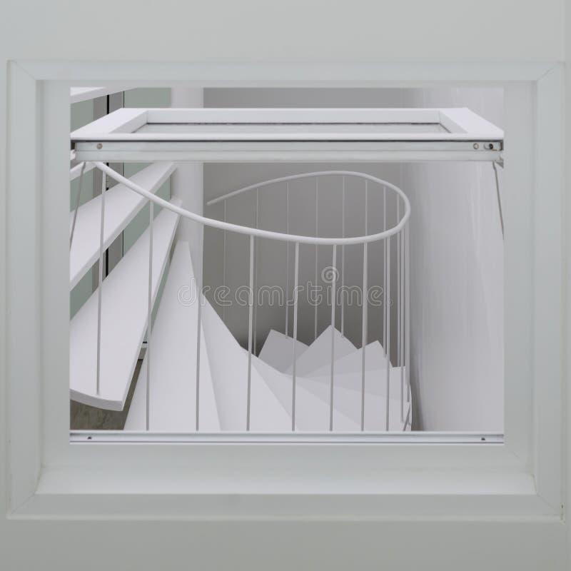 Escada espiral através da janela fotografia de stock royalty free