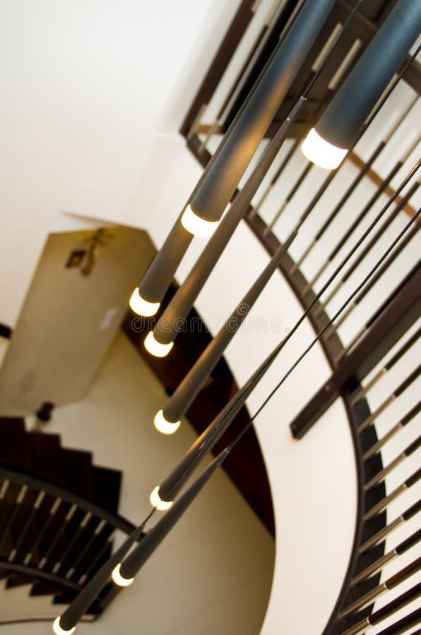 Escadas espirais e iluminação imagens de stock