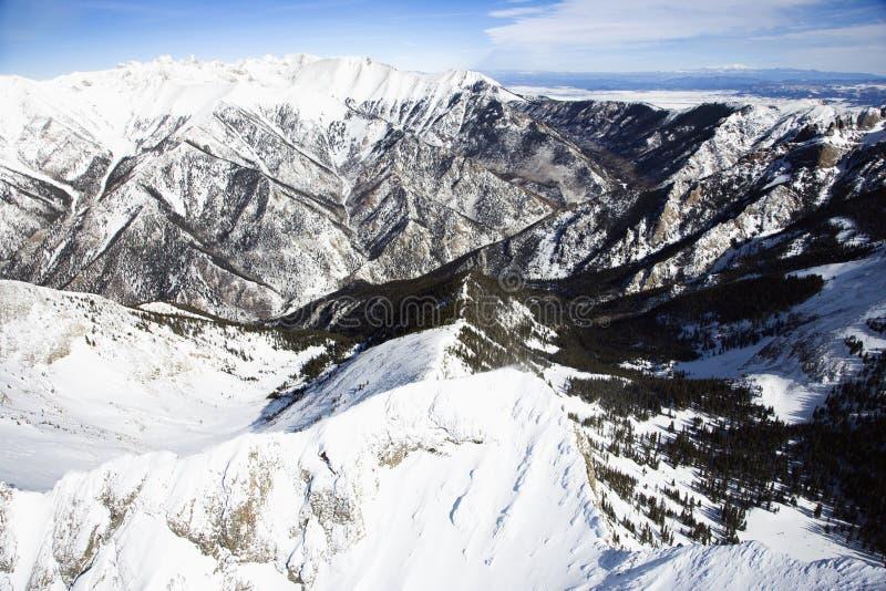 Escala de montanha nevado imagem de stock royalty free