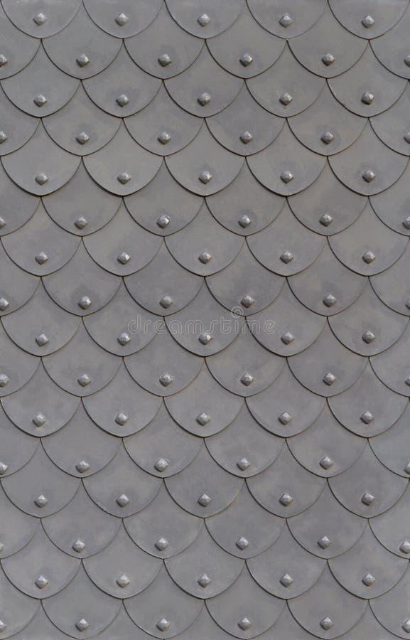 Escala de pescados de la armadura del metal con los remaches imágenes de archivo libres de regalías