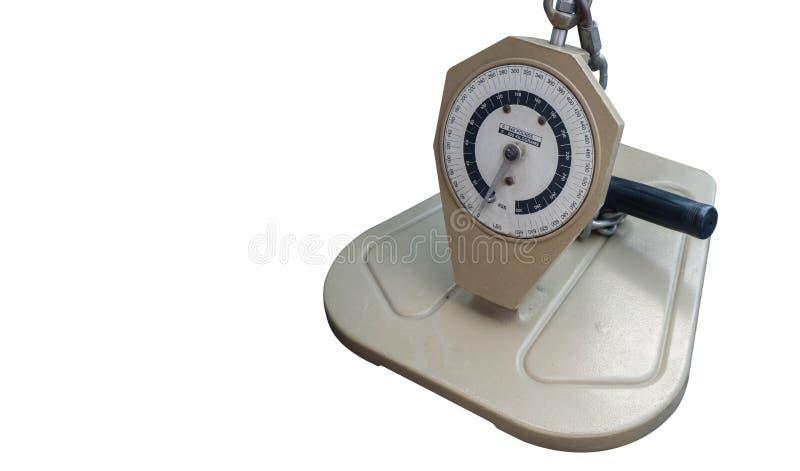 Escala de peso de creme antiga no fundo branco, espaço da cópia fotografia de stock