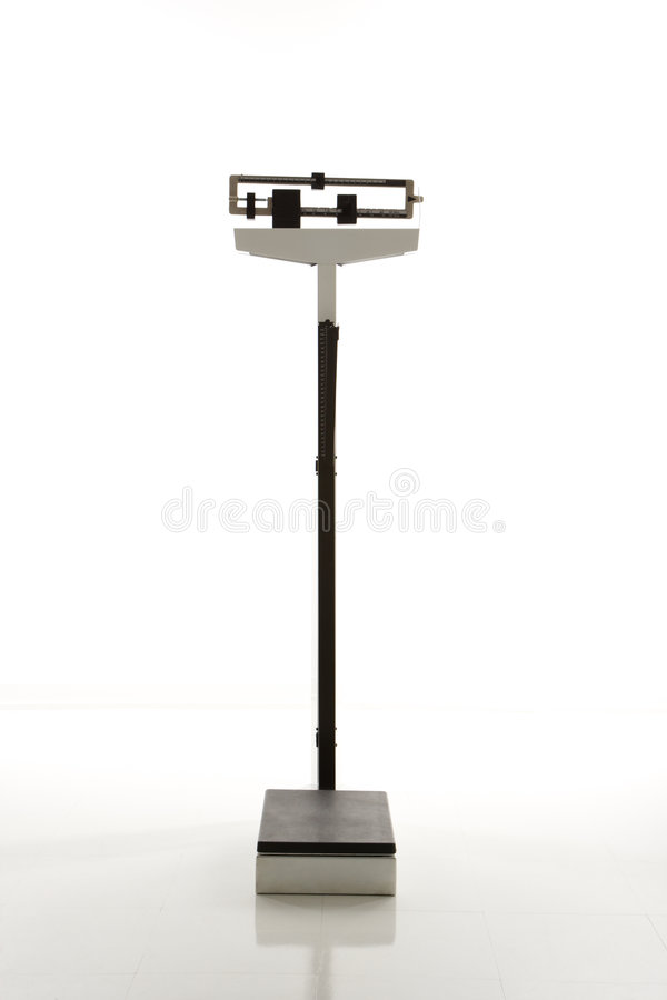 Escala derecha del peso. fotografía de archivo