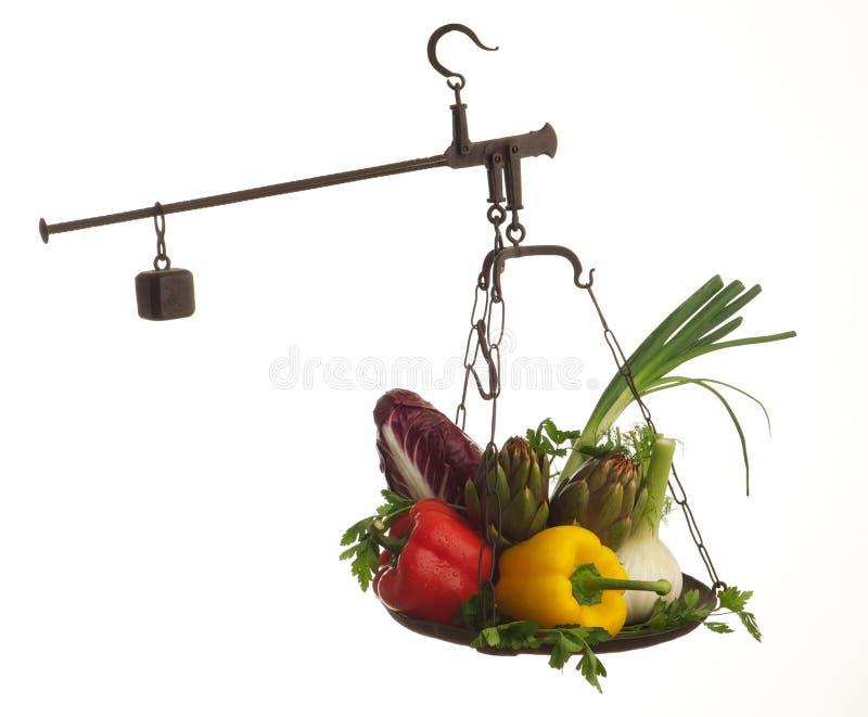 Escalas com vegetais foto de stock royalty free