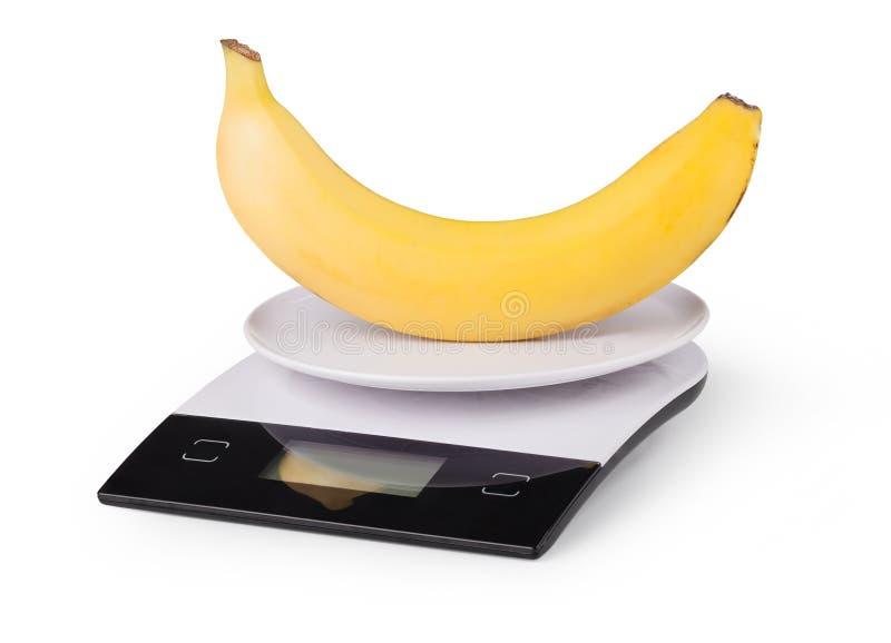 Escalas eletrônicas com banana imagem de stock royalty free