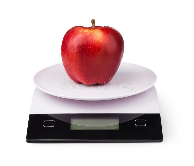 Escalas eletrônicas com maçã imagem de stock royalty free