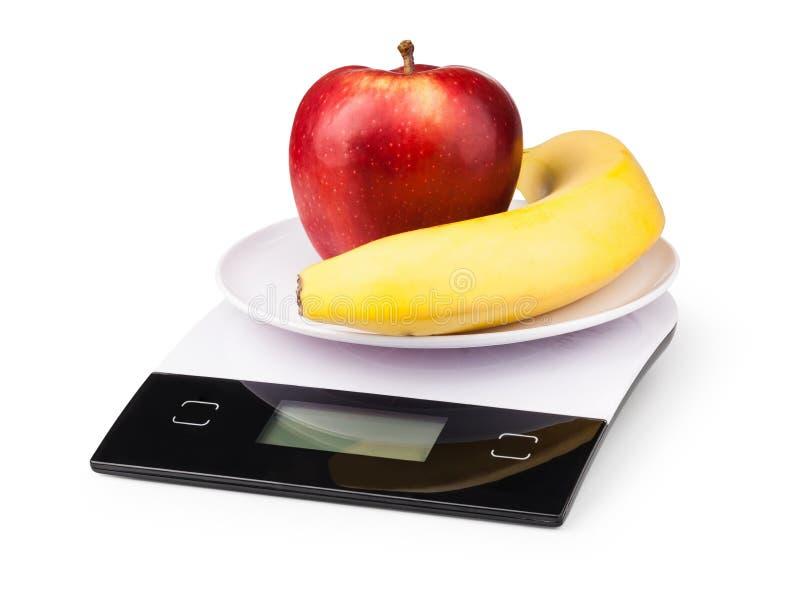 Escalas eletrônicas com maçã imagem de stock