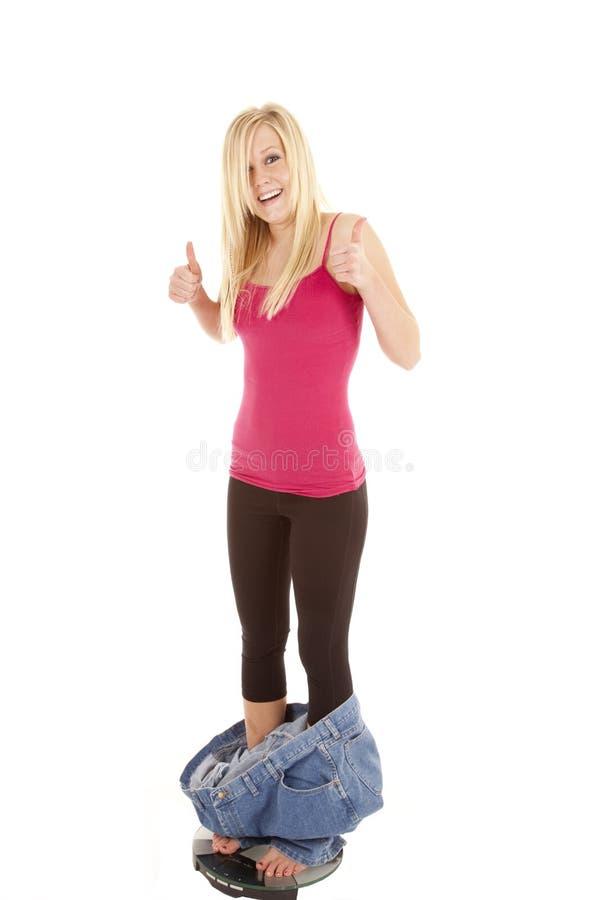 Escalas grandes da queda das calças foto de stock