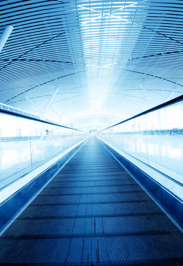 Escalator. Moving escalator in an airport royalty free stock photo