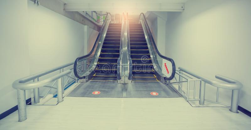 Escalator in business office building. Moving up staircase. royalty free stock images