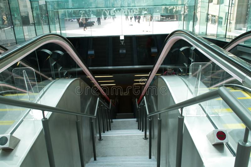 Escalator in busy center of Glasgow royalty free stock photo