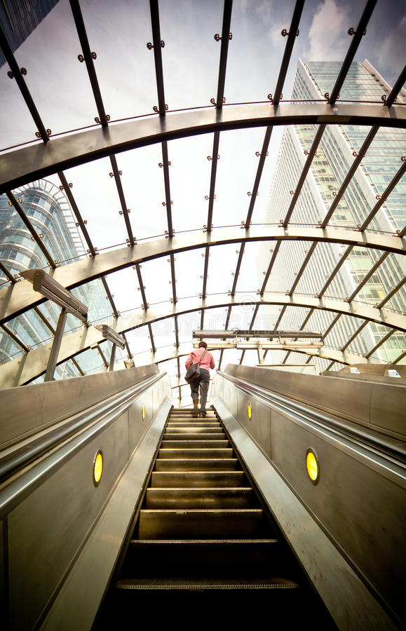 Escalator at Canary Wharf. Escalator going up at Canary Wharf Tube station, London financial centre stock image