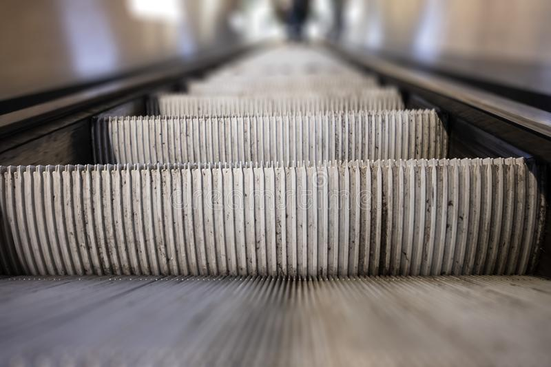 Escalator close-up with blur royalty free stock photo