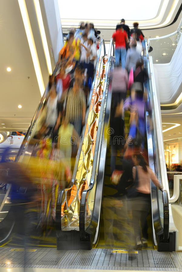 Escalator elevator channel corridor passageway lift hurried travelers royalty free stock image