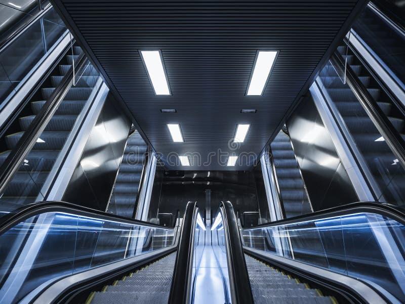 Escalator in Modern building Neon light Interior Futuristic Background. Architecture abstract stock photos