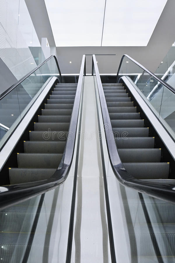 Escalator in a modern interior with stainless steel stock images