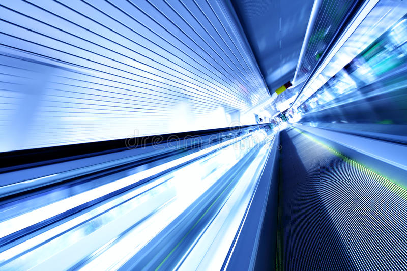 Escalator In Motion Stock Images