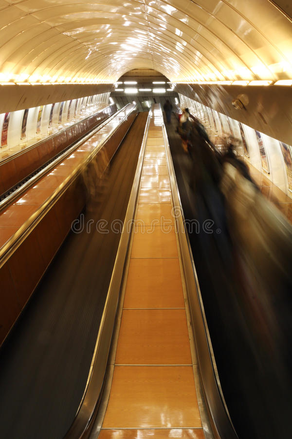 Escalator With People Stock Photo