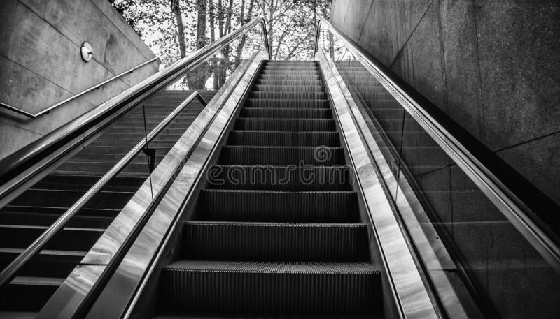 Escalator for people. Transport detail in interior station escalators metro airport travel person modern city elevator mall view building architecture stock photos