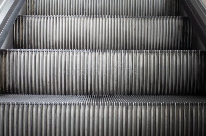 Escalator step on Old Escalator travelling upward. Escalator step on an Old Escalator travelling upward stock image
