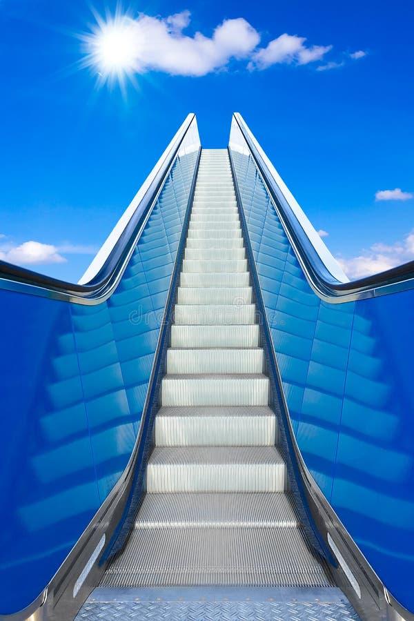 Escalator blue sky bright future. Escalator to the blue sky , concept of rising, way to success or heaven, prospect of a bright future stock photo
