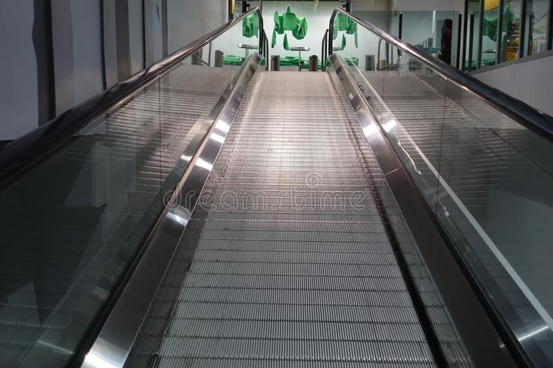 Escalator for trolley shopping car in depart meant store for customer use in case. They have a lot of products stock images