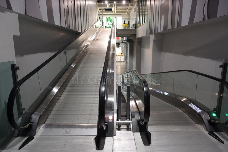 Escalator for trolley shopping car in depart meant store for customer use in case. They have a lot of products royalty free stock images