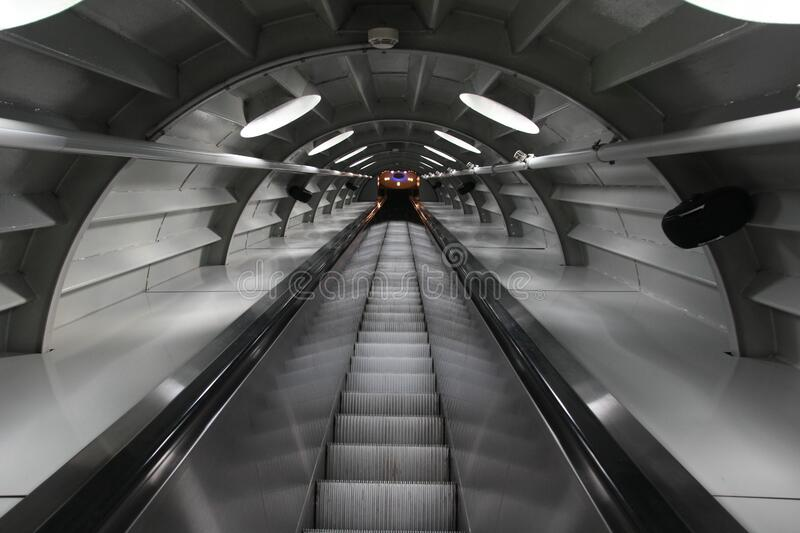 Escalator in tunnel royalty free stock photo