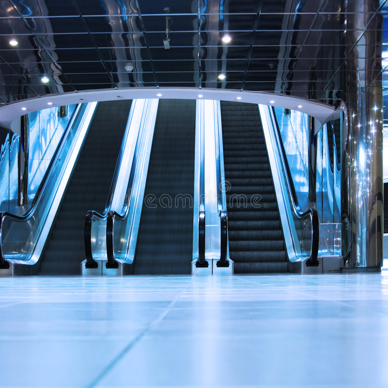 Escalators. Modern interior of trade center royalty free stock images