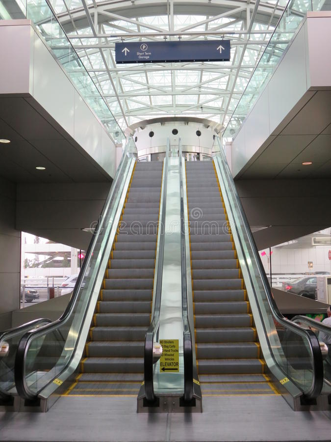 Escalators Inside An Airport Stock Photo - Image of moving ...