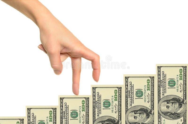 Escalera femenina de la mano y del dinero foto de archivo libre de regalías