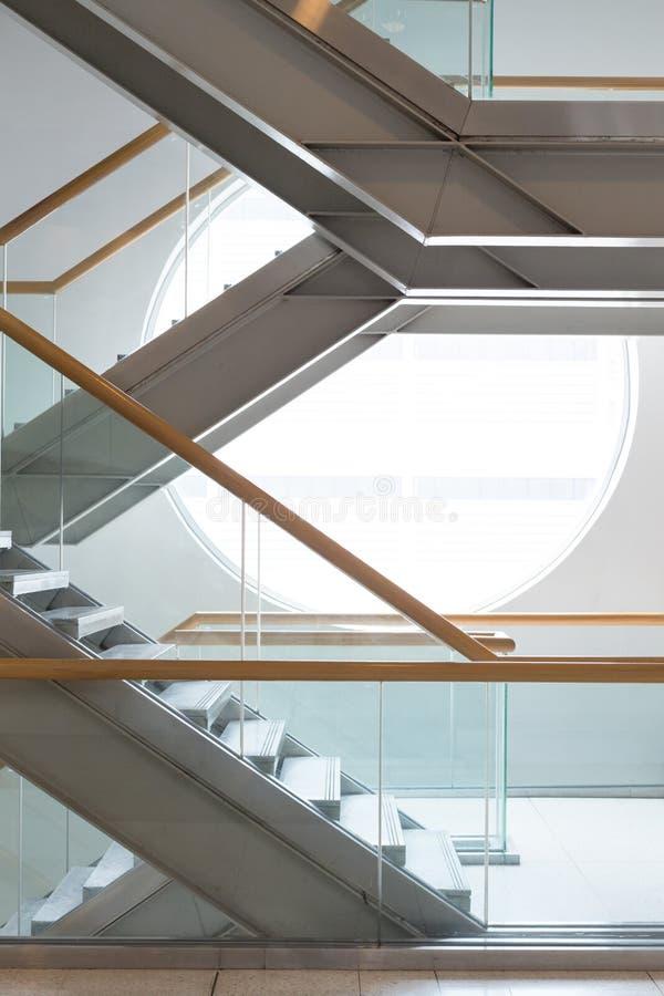 Escaleras de acero y ventana redonda imagen de archivo libre de regalías