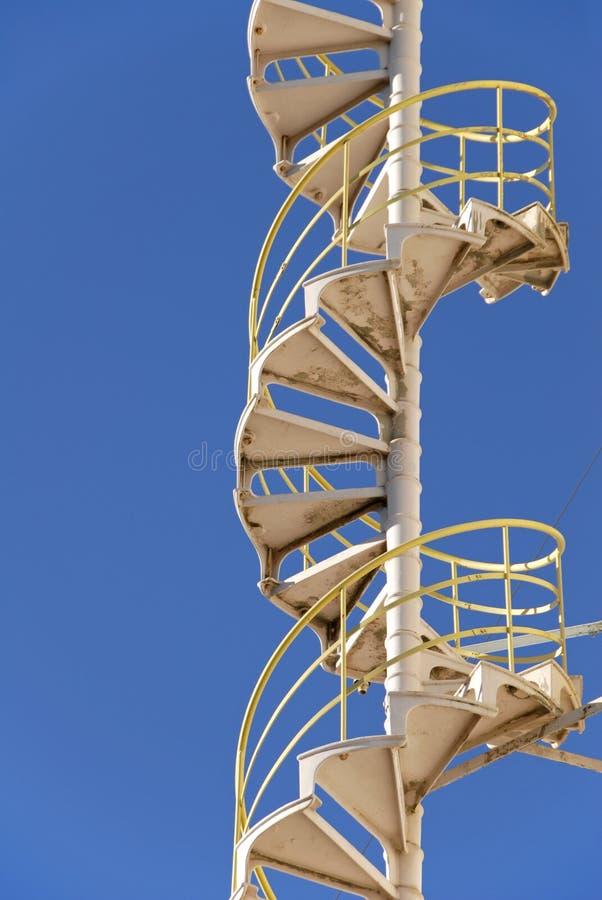 Escaleras espirales industriales imagen de archivo libre de regalías