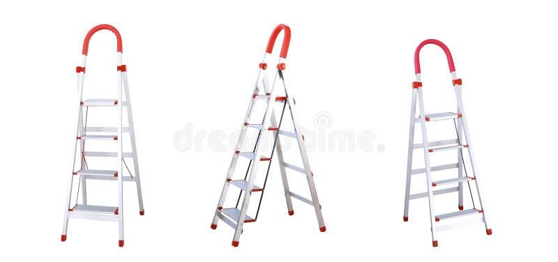 Escaleras plegables de aluminio con la barra de la mano aislada en el fondo blanco fotos de archivo libres de regalías