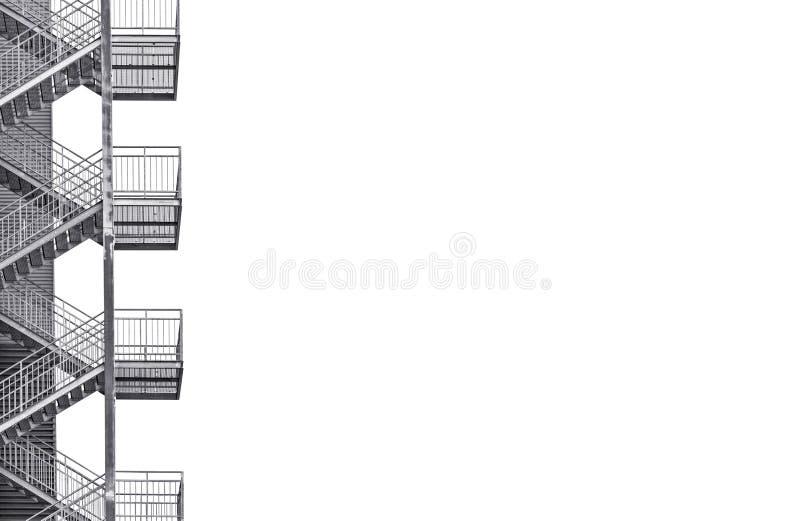 Escalier industriel en métal sur le fond blanc images libres de droits
