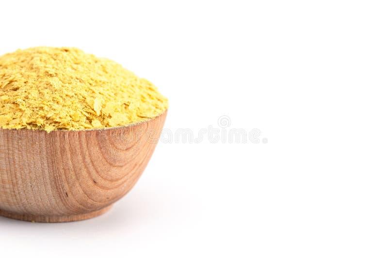Escamas de la levadura alimenticia amarilla un substituto del queso y aderezo para las dietas del vegano imagenes de archivo