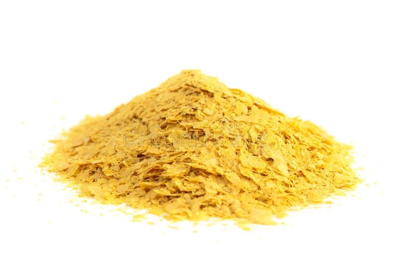 Escamas de la levadura alimenticia amarilla un substituto del queso y aderezo para las dietas del vegano imágenes de archivo libres de regalías