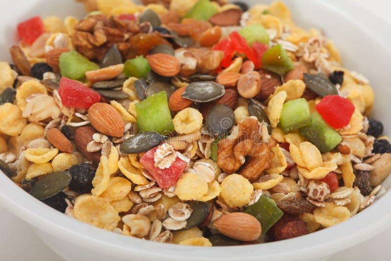 Escamas Nuts de los cereales de la pasa de la avena de las frutas secas de Muesli imágenes de archivo libres de regalías
