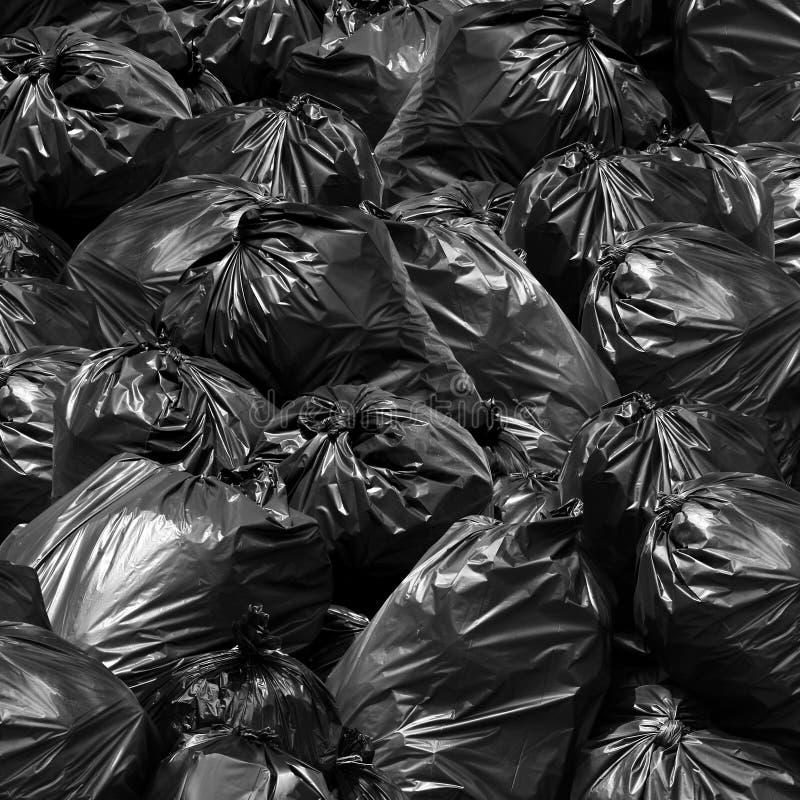 Escaninho do preto do saco de lixo do fundo, descarga de lixo, escaninho, lixo, Garba foto de stock royalty free