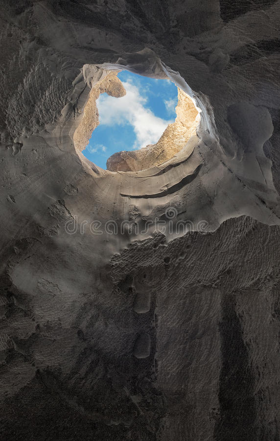 Escape from cave. Escape from a deep cave royalty free stock photo