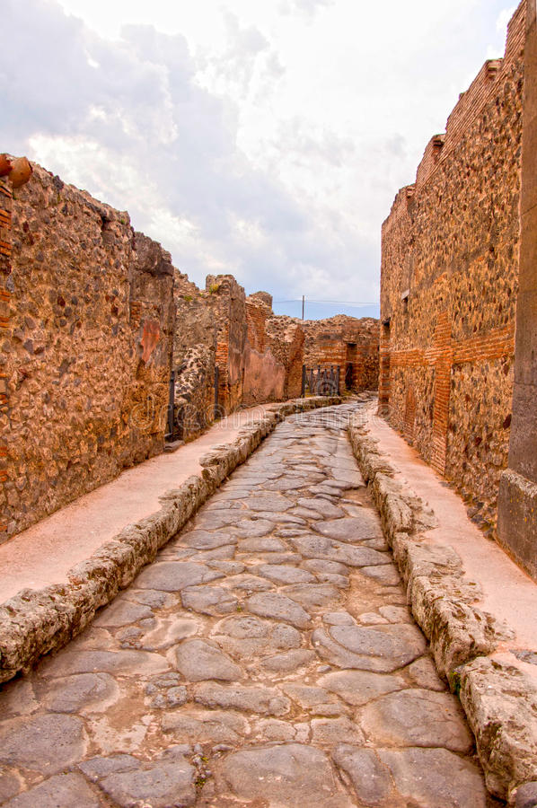 Escape from Pompeii. One of the streets of Pompeii city destroyed by the eruption of Vesuvius and famous for its culture. Its ruins are now visited by millions royalty free stock image