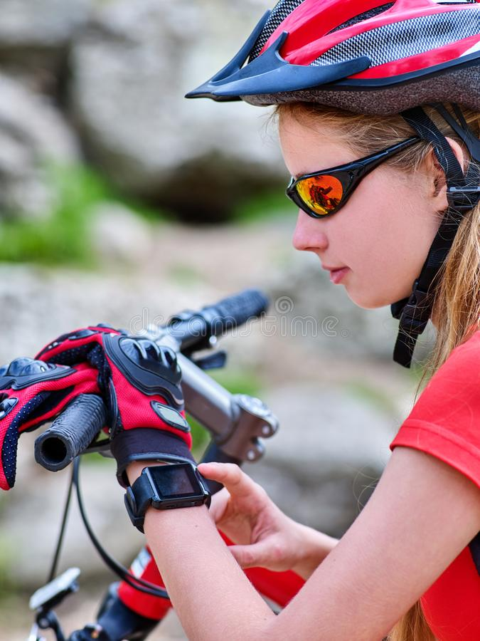 Escape urban. Bicycle girl wearing helmet rest from city urbanization. Escape urban. Bicycle girl has rest from city bustle. Woman wearing sport helmet rides stock image