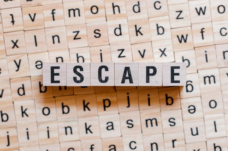 Escape word concept. On cubes stock photography