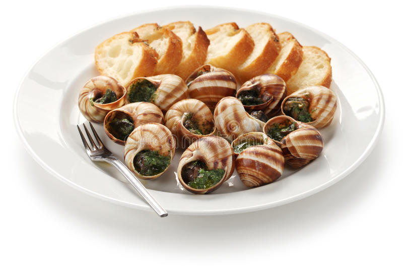 Escargot, caracóis um bourguignonne do la foto de stock royalty free
