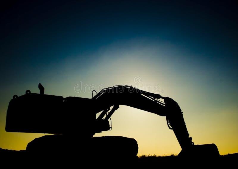 Escavador do por do sol foto de stock