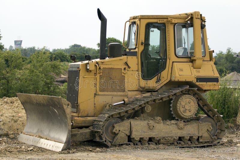 Escavadora amarela foto de stock royalty free