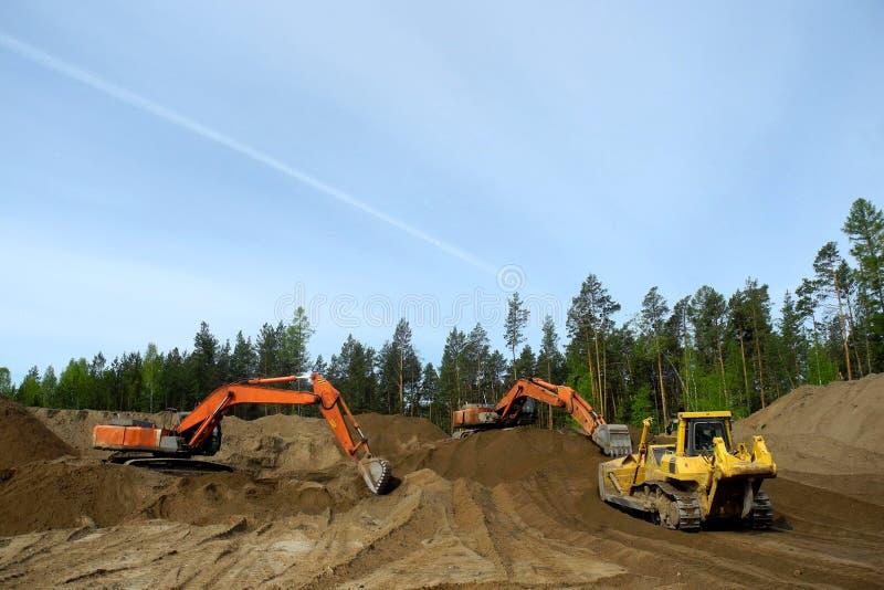 Escavadora e máquina escavadora imagem de stock